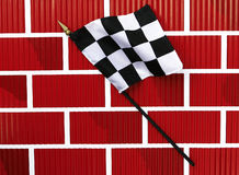 Black and White Finish Line Checkered Flag. Rippled Wavy Black and White Finish Line Checkered Flag isolated on brick wall background Royalty Free Stock Image