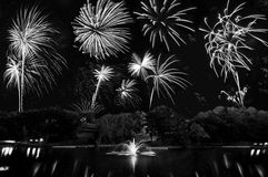 Black And White Fireworks Celebration. Black and white rendition of beautiful fireworks over a dreamy lake Stock Photo