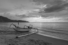 Black and white : Fisherman boat with cloudy skies Stock Photo