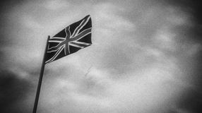 Black and white flag of the UK in a wind stock video
