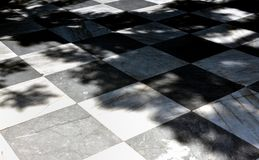 Black and white floor tiles. Checkerboard of black and white floor tiles royalty free stock photos