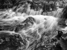 Black and white flowing stream. Black and white flowing water Royalty Free Stock Image