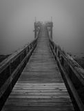 Black and White Foggy Pier Royalty Free Stock Images