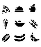 Black and white food icons. Set of black and white food icons with a slice of pizza, dome, apple, ice cream cone, kebabs, hot dog, sausages, a croissant and a Stock Images