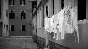 Black and white footage: laundry is drying on the streets on Venice.  stock video footage