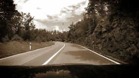 Black and White Footage: Mountain road inside car view near Rabac, Croatia stock video footage