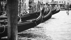 Black and white footage of Venetian gondolas rocking on waves stock video