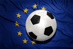 Black and white football ball on the european union flag Royalty Free Stock Photography