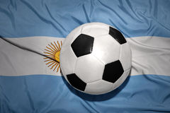 Black and white football ball on the national flag of argentina Stock Photos