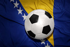 Black and white football ball on the national flag of bosnia and herzegovina Royalty Free Stock Photos