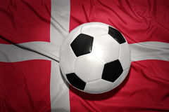 Black and white football ball on the national flag of denmark Royalty Free Stock Photo