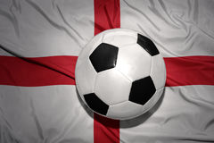 Black and white football ball on the national flag of england Stock Photo