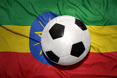 Black and white football ball on the national flag of ethiopia Stock Images