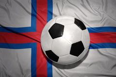 Black and white football ball on the national flag of faroe islands Stock Image