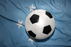Black and white football ball on the national flag of Federated States of Micronesia Royalty Free Stock Image