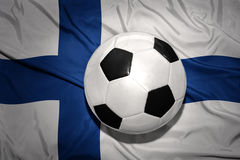 Black and white football ball on the national flag of finland Stock Photography