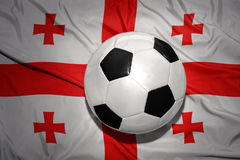 Black and white football ball on the national flag of georgia. Vintage black and white football ball on the national flag of georgia Royalty Free Stock Images