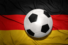 Black and white football ball on the national flag of germany Royalty Free Stock Photo