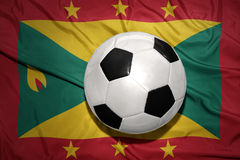 Black and white football ball on the national flag of grenada Royalty Free Stock Photography