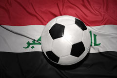 Black and white football ball on the national flag of iraq Royalty Free Stock Photos