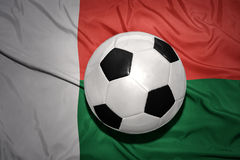 Black and white football ball on the national flag of madagascar. Vintage black and white football ball on the national flag of madagascar Stock Photos