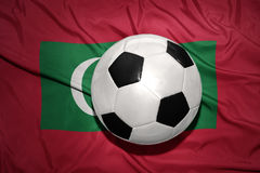 Black and white football ball on the national flag of maldives Stock Photo