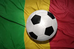 Black and white football ball on the national flag of mali. Vintage black and white football ball on the national flag of mali Royalty Free Stock Photo