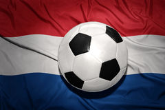 Black and white football ball on the national flag of netherlands, dutch, amsterdam, Royalty Free Stock Images