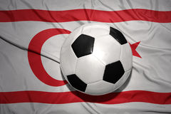 Black and white football ball on the national flag of northern cyprus Stock Photo