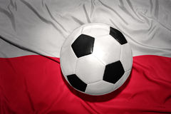 Black and white football ball on the national flag of poland Stock Image