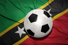 Black and white football ball on the national flag of saint kitts and nevis Royalty Free Stock Images