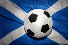 Black and white football ball on the national flag of scotland stock images