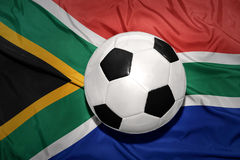 Black and white football ball on the national flag of south afri Stock Photography