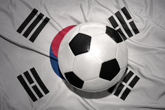 Black and white football ball on the national flag of south korea. Vintage black and white football ball on the national flag of south korea royalty free stock photography