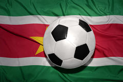 Black and white football ball on the national flag of suriname Royalty Free Stock Photography