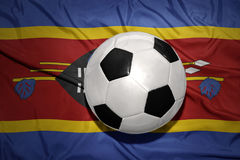 Black and white football ball on the national flag of swaziland Stock Images