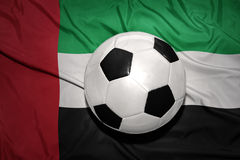 Black and white football ball on the national flag of united arab emirates Stock Photos