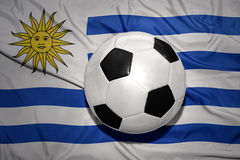 Black and white football ball on the national flag of uruguay Stock Photo