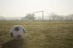 Black and white football on  football pitch Stock Photography