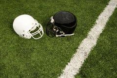 Black and white football helmets Royalty Free Stock Photo