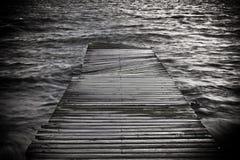 Black and white footbridge. Black and white creative photo of a footbridge Stock Photo
