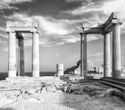 Black and white foto of Lindos Acropolis ruins with columns and portico. Lindos Acropolis ruins with columns and portico Royalty Free Stock Image