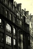 Black and white french building - sun rising. On clear windows royalty free stock photo