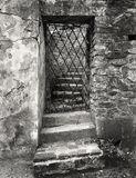 Black and white gate in the wall Stock Photography