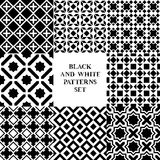 Black and white geometric tiles seamless patterns set, vector Stock Images