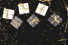 Black and white gift boxes with gold ribbon on shine background. Flat lay. Copy space stock photography