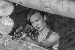 Black and white, the girl with the arms in a wooden defensive fo. Black and white, in the hands of the girl`s arms, she in a defensive wooden fortification Stock Photos