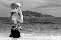 Black and white girl on the beach at Thailand. Black and white photograph for background, tourist girl in swimsuit standing with happiness on the beach and sea Royalty Free Stock Photos