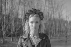 Black and white, the girl in the black wreath of flowers looking. Black and white, portrait of girl with wreath of black flowers on his head Stock Photo