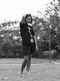 Black and white girl standing comfortably. Black and white young girl pretending to Thailand were standing comfortably in the park Royalty Free Stock Photos